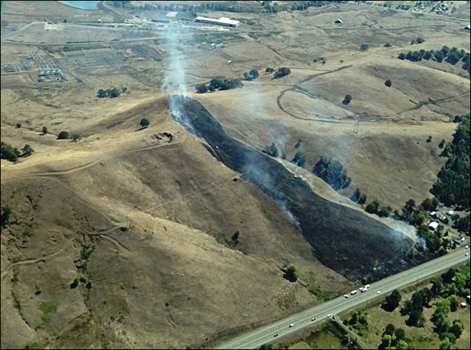 Wind spreads grass fire to 15 acres along Hwy 138E