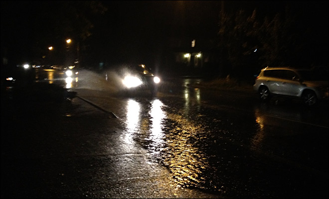 Car plows through large puddle on Hilyard St.