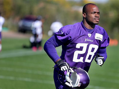 Vikings reinstate Peterson despite abuse charge
