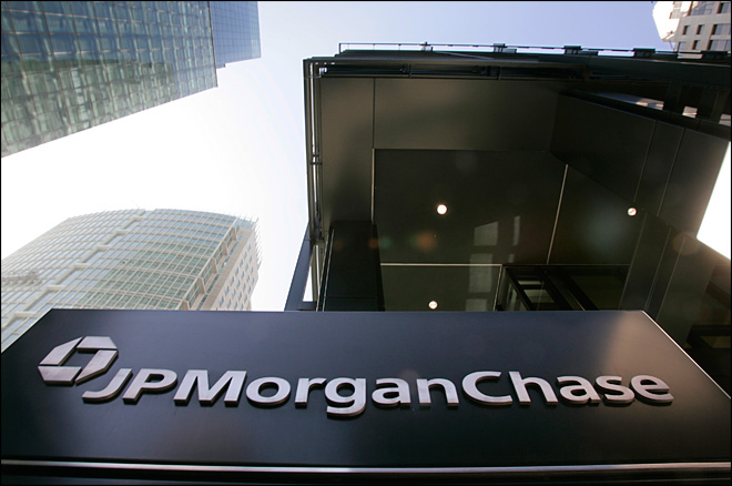 JPMorgan pays $100 million, admits fault in London trades