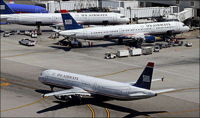 US Airways net income dips on higher taxes