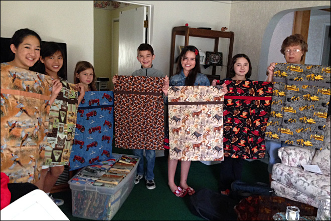 Local kids sew pillow cases for deployed soldiers