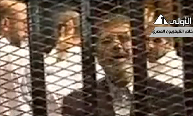 Egypt's Morsi defiant in opening session of trial