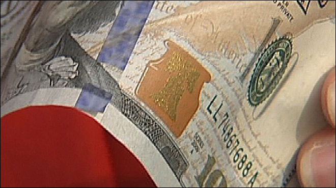 $100 bill cuts counterfeits, but can it withstand wallet wear?