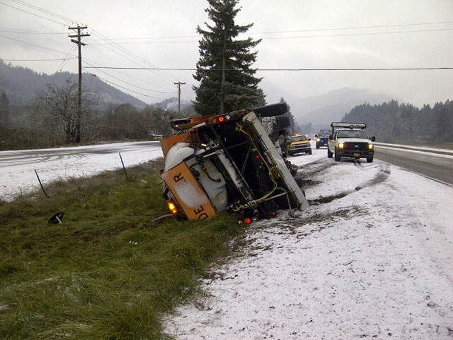 Car hits ODOT de-icer truck on I-5