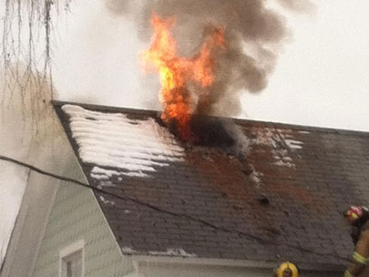 Passersby alert residents to house fire