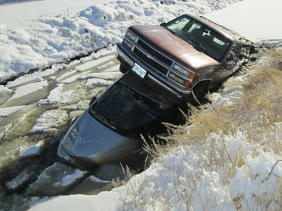 SUV driver loses control passing Prius, sends both cars into icy canal