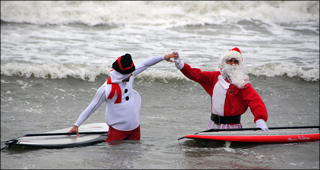 Surfers dressed as Santa Claus gather in Florida