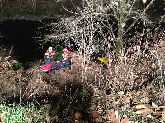 Rope rescue necessary after car drives off 30-foot cliff into river