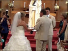 Father sings to daughter as they walk down the aisle