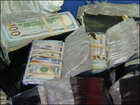 Agents unearth $600,000 in backyard of armored truck driver