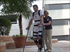 Paralyzed man walks with exoskeleton