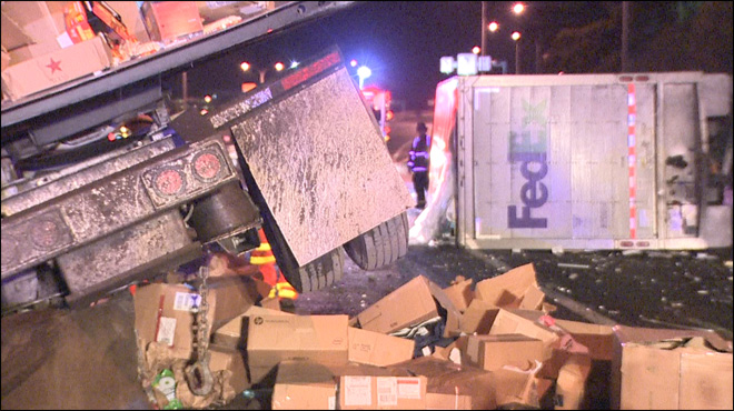 'What a mess!' Semi crash spills packages on Seattle freeway