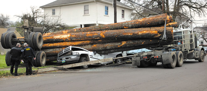 Logs crush Albany man's pickup