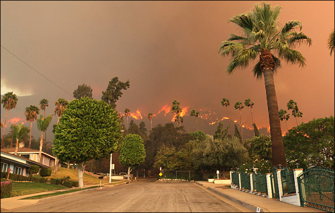 Homes ablaze, evacuations, 3 arrests in S. Calif. wildfire