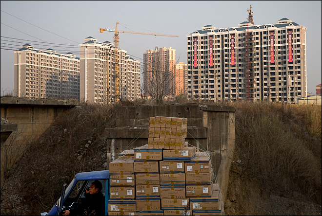 China's economy grows 7.7 percent in 2013
