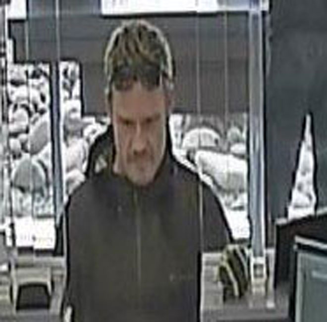 Man with note robs Eugene bank
