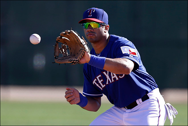 Seahawks' Wilson spends day as Texas Rangers baseball prospect