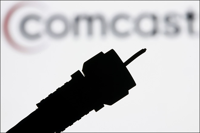 Comcast extends cheap Web access amid deal review