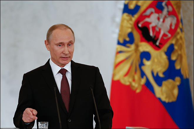 Putin signs treaty, adds Crimea to map of Russia