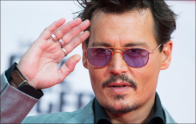 Engaged Johnny Depp shows off 'chick's ring'