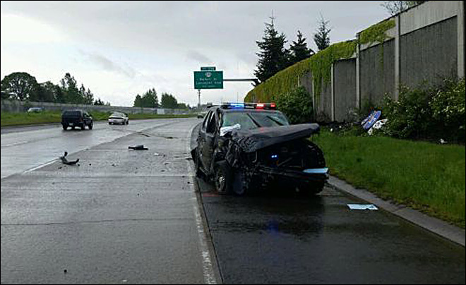 Deputy loses control of car, crashes into cement wall along I-5