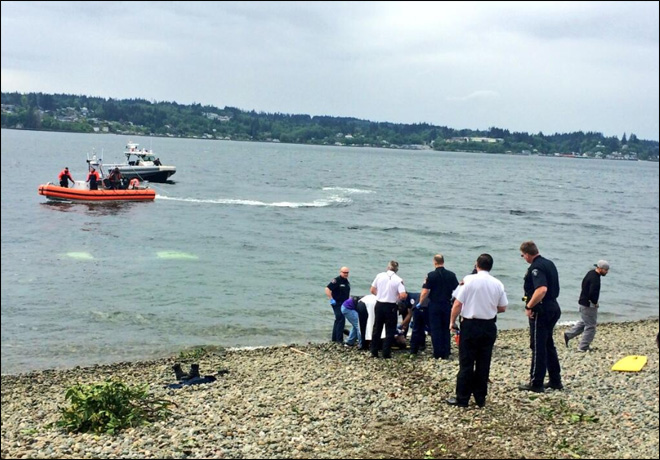 Man rescued after driving car into Puget Sound