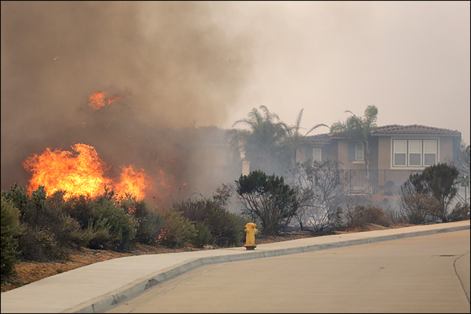 Wildfires burn homes near San Diego