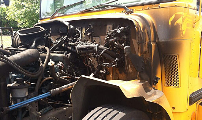 Driver helps students off school bus before engine fire