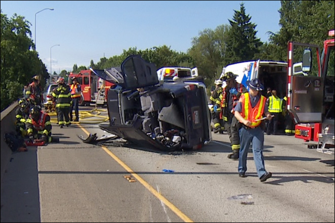 2 injured as SUV rolls over on I-5 to avoid disabled car