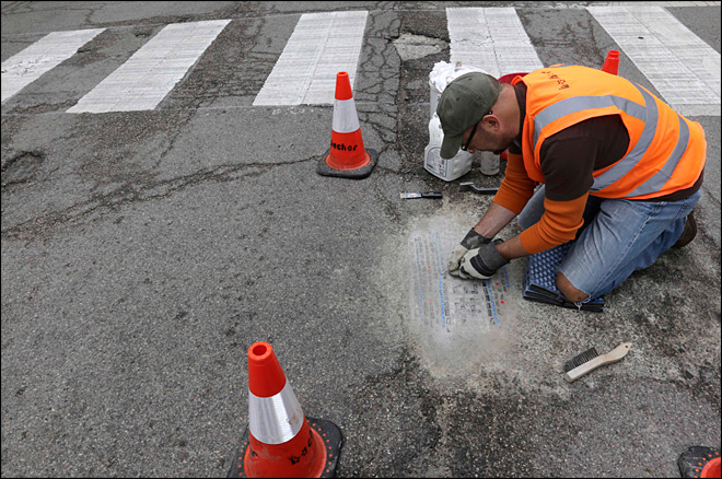 Chicago man filling potholes with a bit of artistic flair