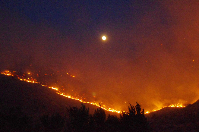 Central Wash. fire now stable; more storms expected