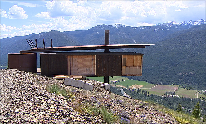 Residents say developer's odd cabin is 'extended third finger' to town