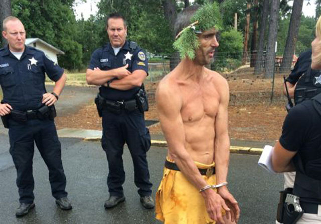 Murder suspect caught wearing loin cloth, tree-branch crown