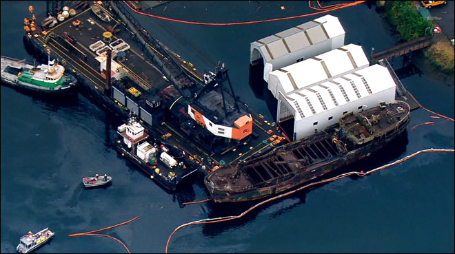 Sunken drug-smuggling freighter being removed from waterway