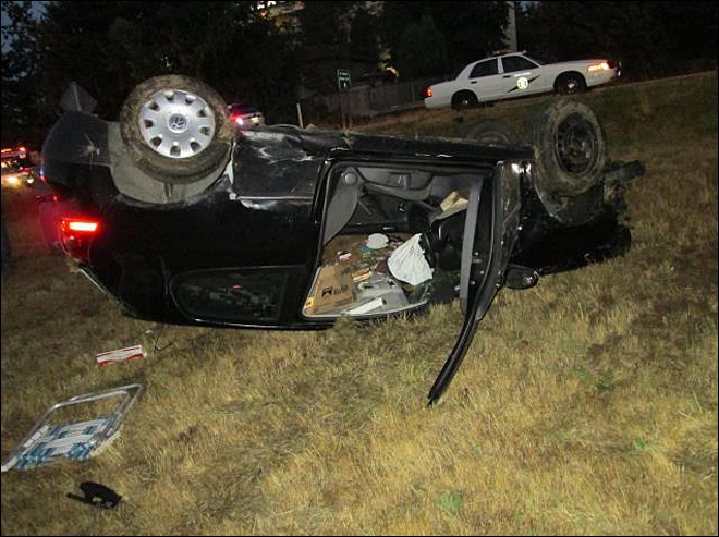 Troopers find naked, unconscious man in crashed SUV near Seattle