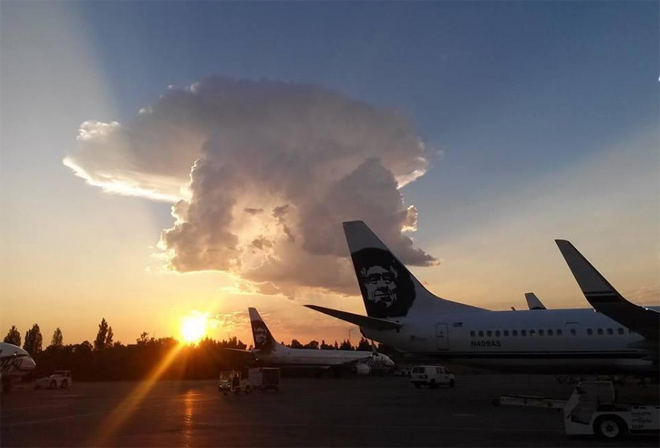 What a shot! 'Face' in clouds mimics Alaska Air jet?