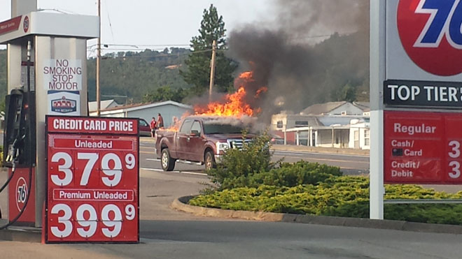 Fire engulfs pickup near gas station