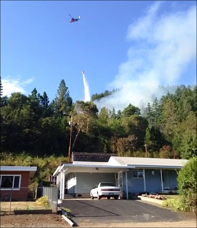 8 homes evacuated by two-acre fire near Oakridge