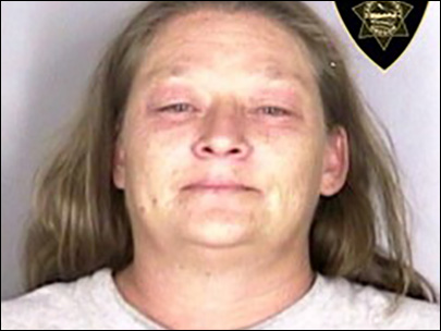 Oregon woman accused of setting husband on fire