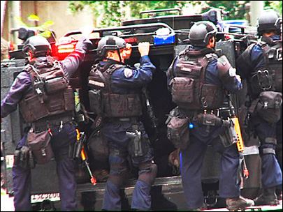 Feds censure local police, yet give lethal weapons