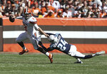 Manziel's 2 TD passes lift Browns over Mariota, Titans 28-14