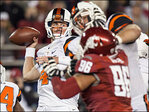 Mannion hits  493 yards, OSU pulls 52-24 win over WSU