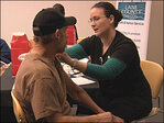 Health officials get a jump on flu season with free clinic
