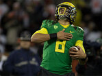 Why does Marcus Mariota tap his heart after scoring touchdowns?