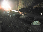 Driver OK after boulders hit car on I-84; rock slide closes interstate