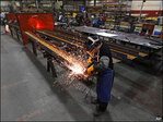 U.S. manufacturing boosted by orders and stockpiles
