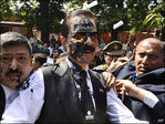 Black ink thrown at Indian tycoon accused of fraud