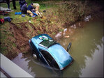 Car misses bridge, lands in creek