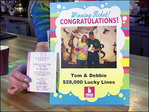Local lottery winner splits jackpot with bartender who served him